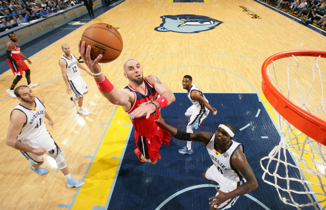 MEMPHIS, TN - APRIL 4: Marcin Gortat #4 of the Washington Wizards shoots against the Memphis Grizzlies on April 4, 2015 at FedExForum in Memphis, Tennessee. NOTE TO USER: User expressly acknowledges and agrees that, by downloading and or using this photograph, User is consenting to the terms and conditions of the Getty Images License Agreement. Mandatory Copyright Notice: Copyright 2015 NBAE (Photo by Joe Murphy/NBAE via Getty Images)